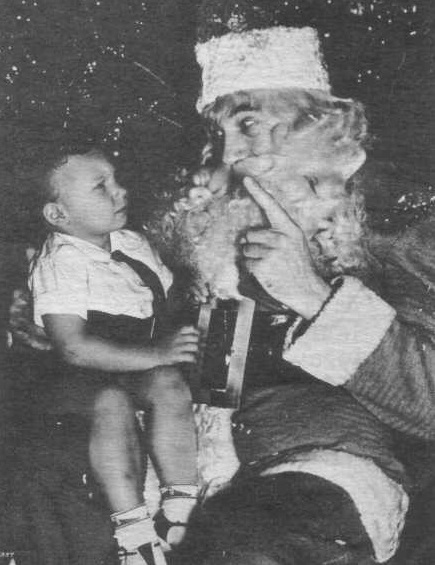 Bela as Father Christmas with Bela Jr.
